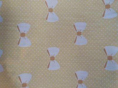 Piqué Canutillo Estampado Lazos Blanco sobre Amarillo